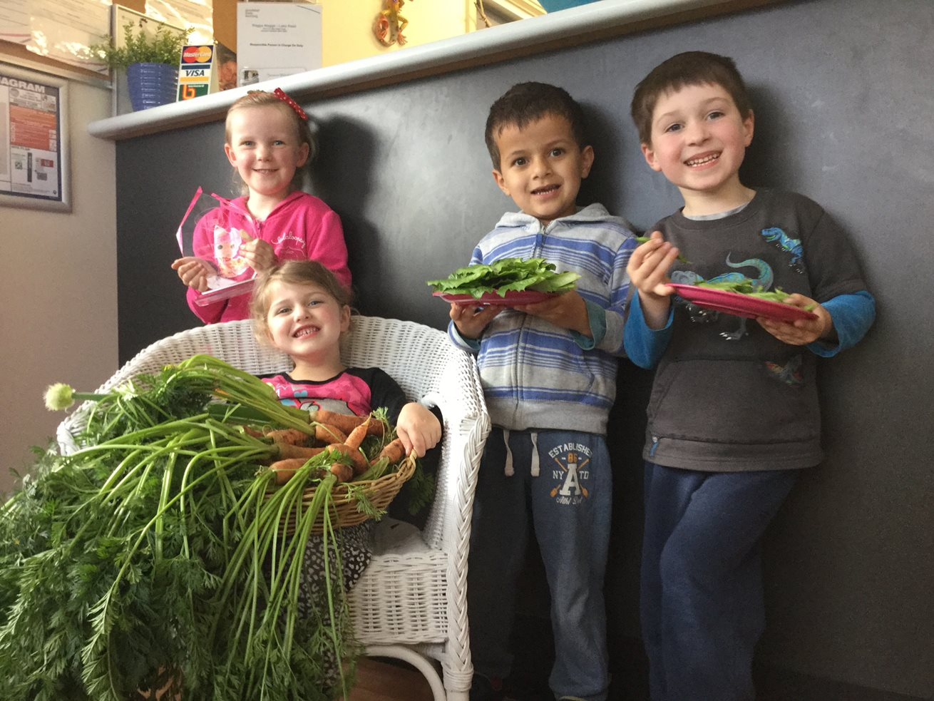 Preschoolers harvest veggies straight from the garden to their lunch box